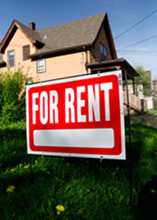 for-rent-sign-in-yard on tenant screening blog