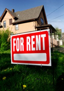 for rent sign in yard on tenant screening blog