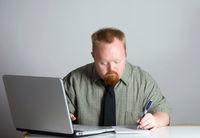 man-writing-at-laptop