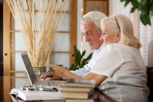 older-couple-on-computer on tenant screening blog